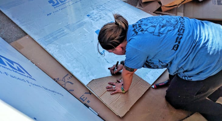 Tracing stencil on the foam insulation
