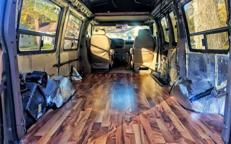 installing t lock laminate flooring in our conversion van gnomad home. Black Bedroom Furniture Sets. Home Design Ideas