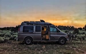 Conversion van parked with a beautiful sunset