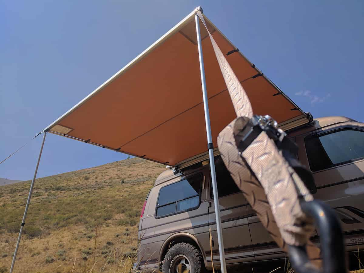 arb awning staked down against wind_1200x900