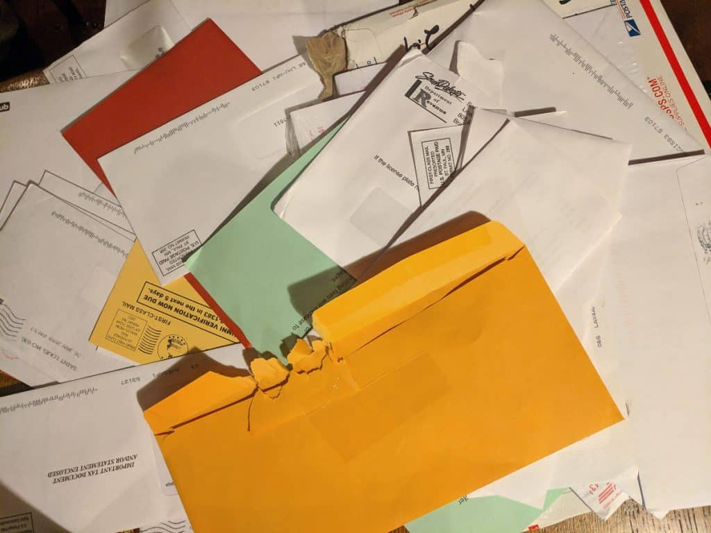 many pieces of mail sprawled out on a table