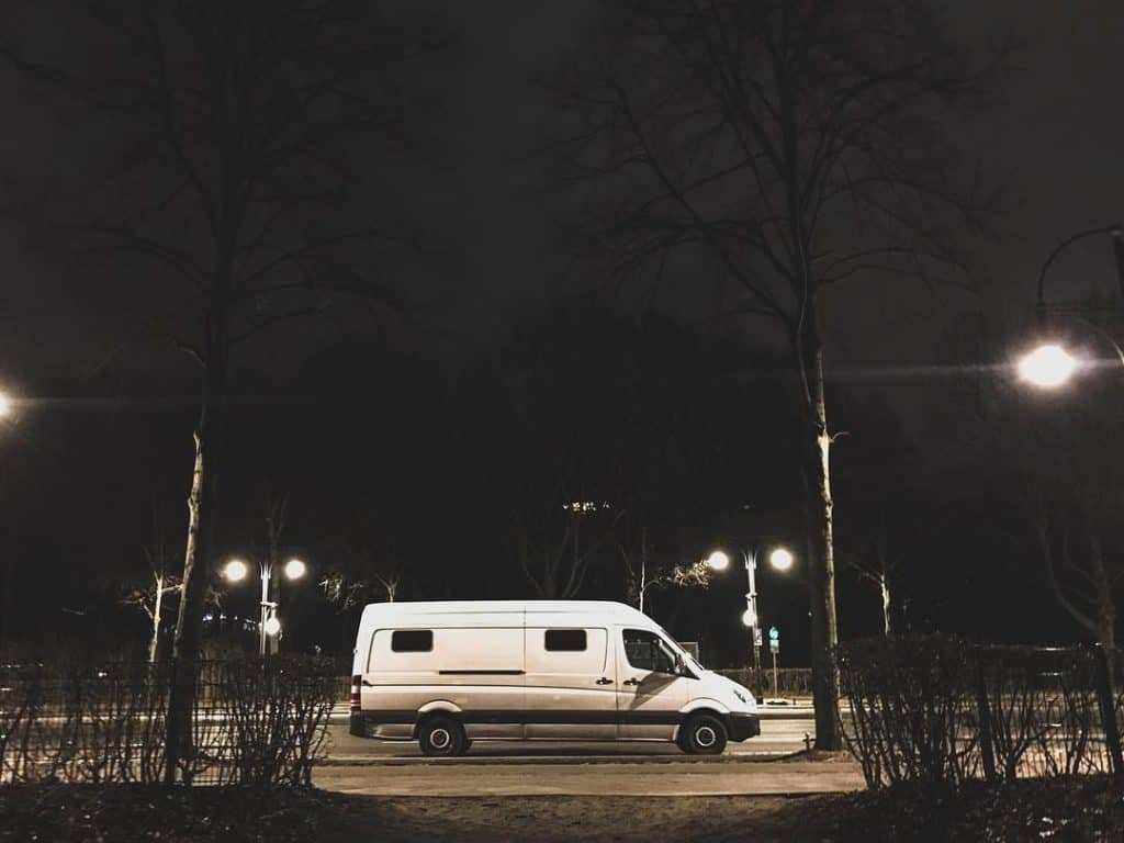 Van parked on city street at night