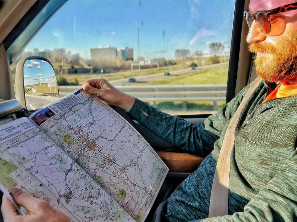 man reading map in passenger seat