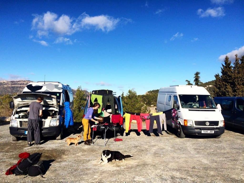 people doing laundry across multiple vans