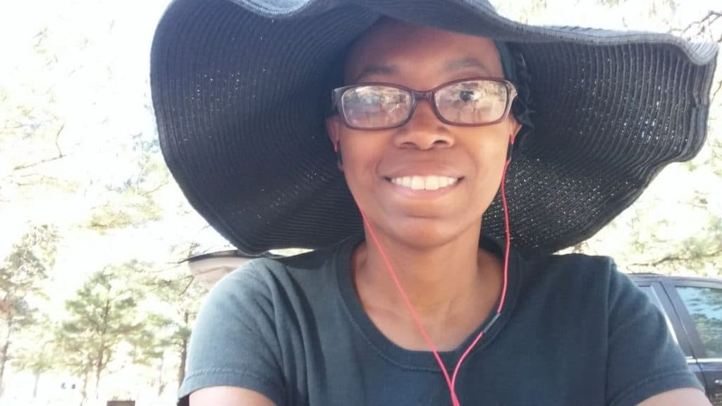 Crystal takes a selfie while rocking a wide-brimmed, floppy black hat