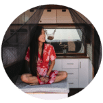 Maggie from bitesizedtravels sits in her van