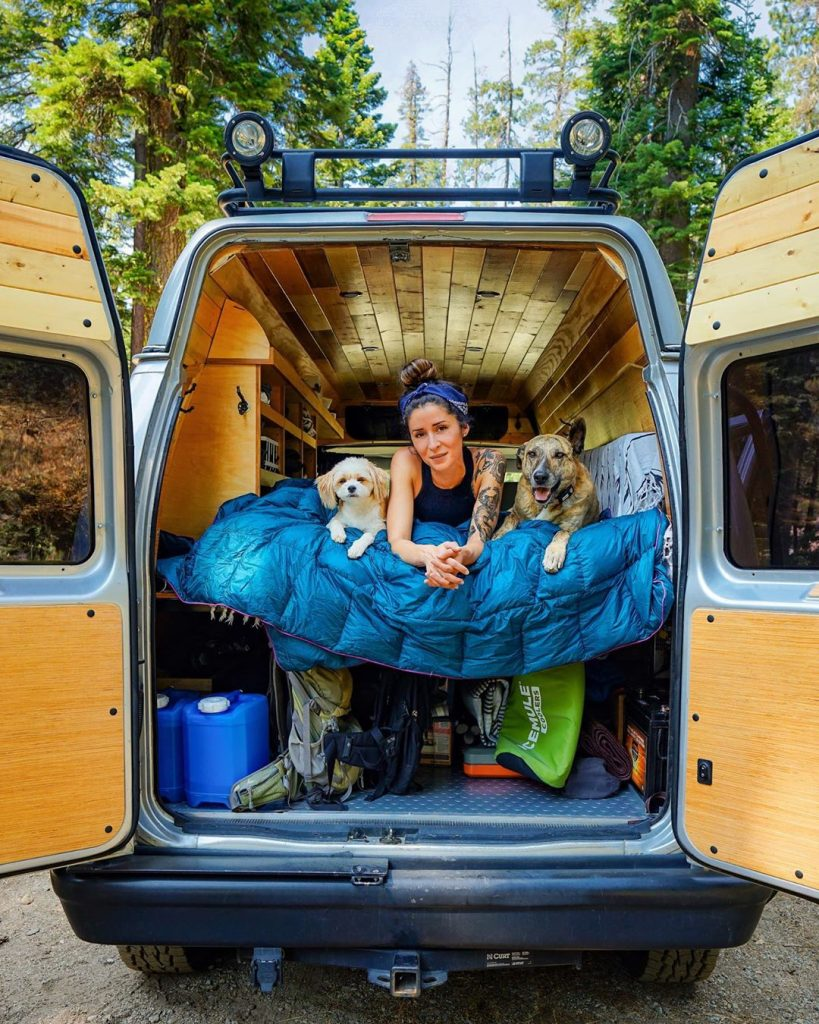 Noel Russ hangs out in her van with her two dogs