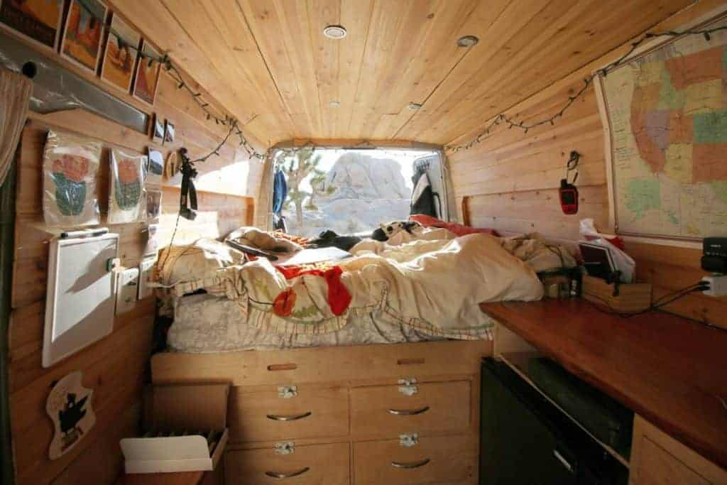 A view of the interior back section of the van showcasing Kaya's bed.