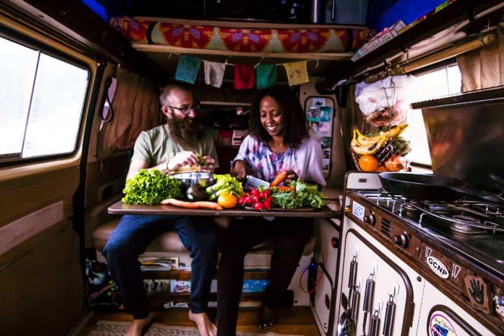 Dustin in Noami in the van surrounded by veggies.