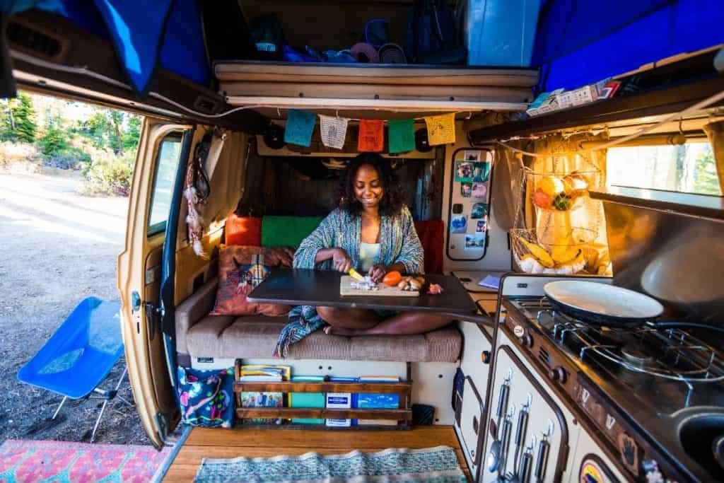 Noami preps food in the van.