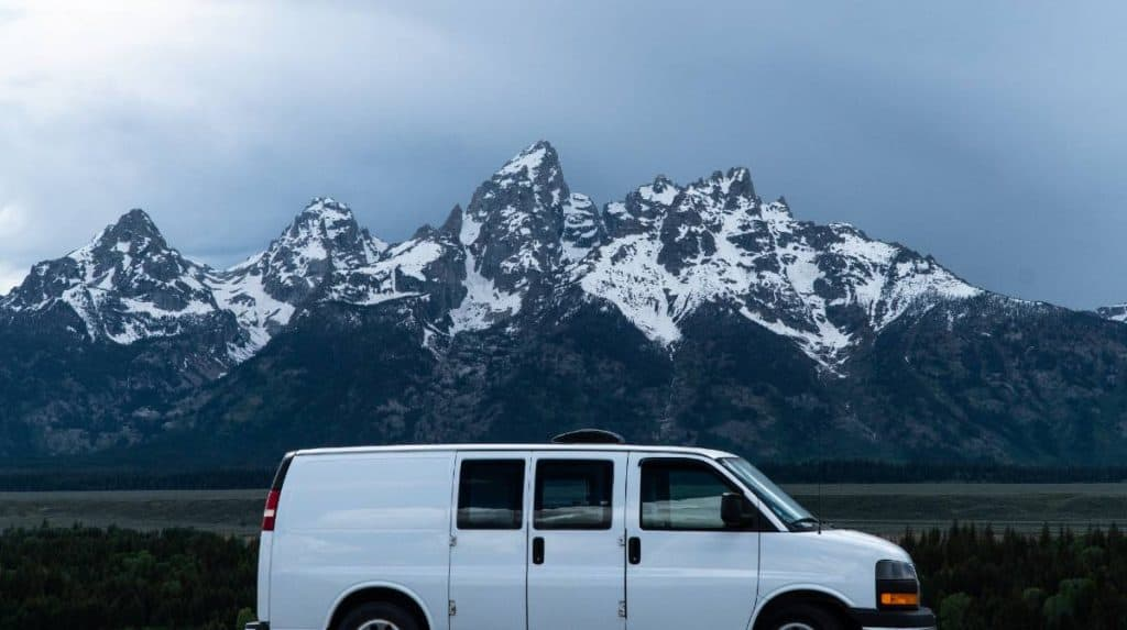 The van parked in front of the Grand Tetons.