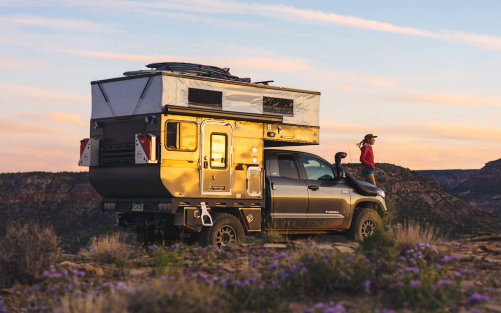 truck camper parked in the desert