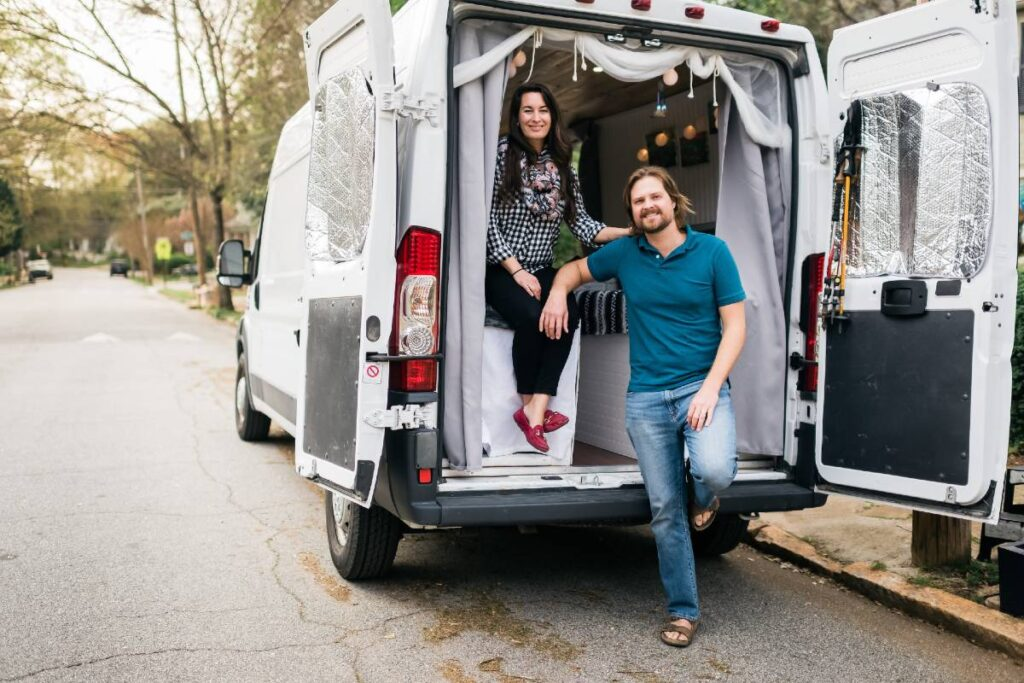 Van couple posing by their dodge ram promaster