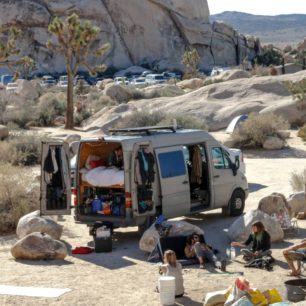 sprinter van parked among the rocks near joshua tree