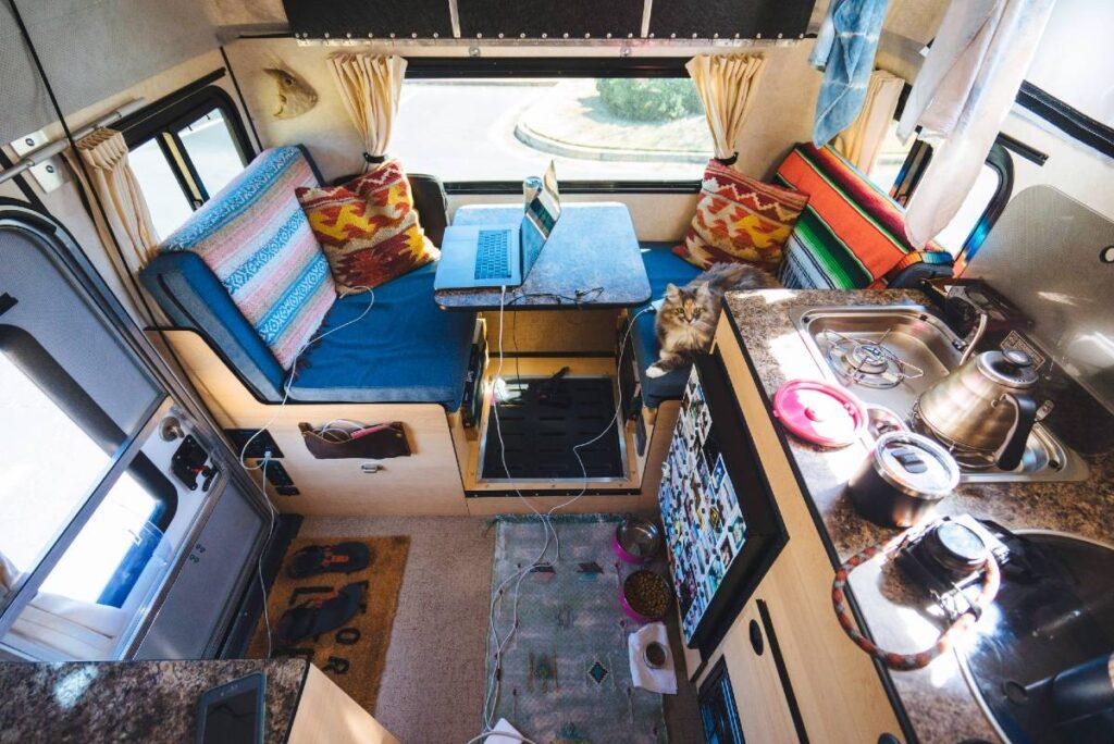 Dinette area workspace of truck camper
