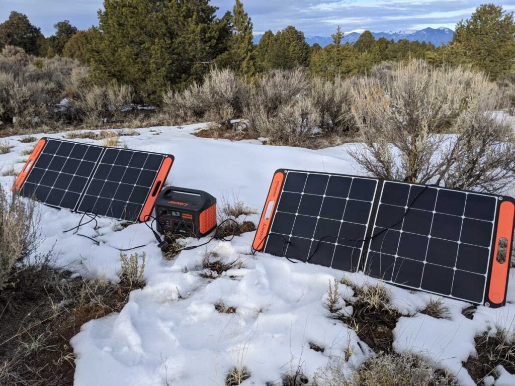 The Jackery Explorer 1000 being charged by two Solar Saga solar panels