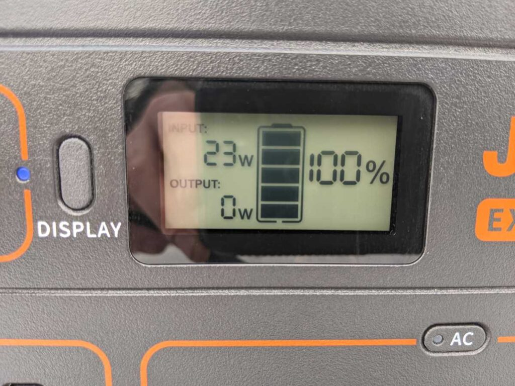 Close up of Jackery 1000 display showing watts, watts out, and charge percentage
