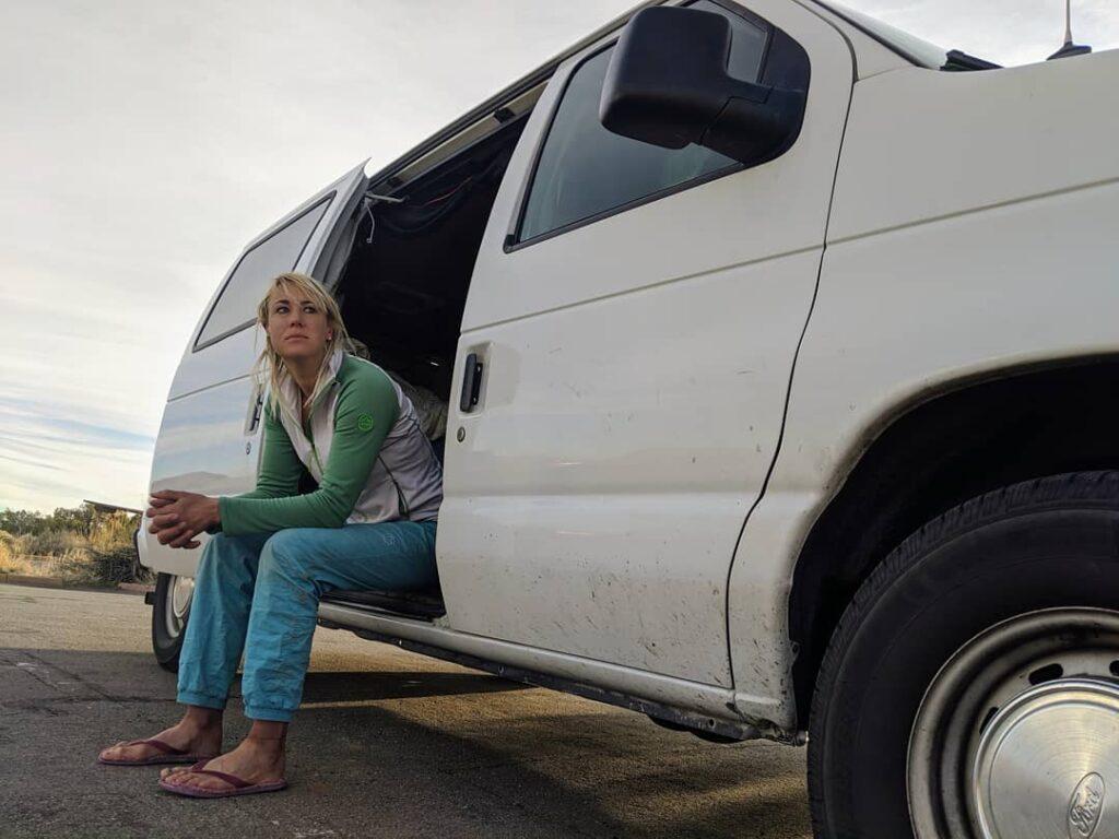 Pro rock climber sitting in her van