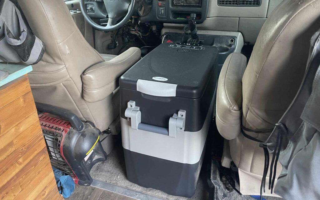 BougeRV refrigerator between the front seats of van